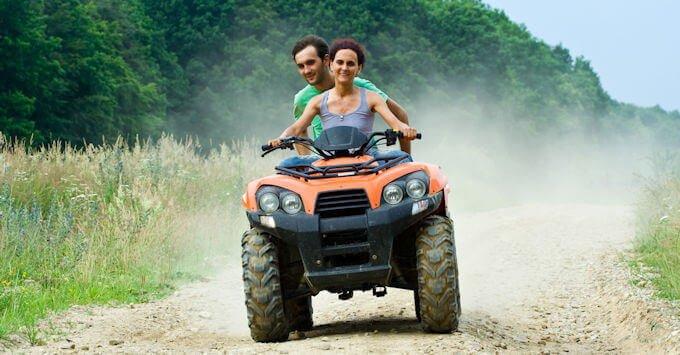 Young couple on an ATV