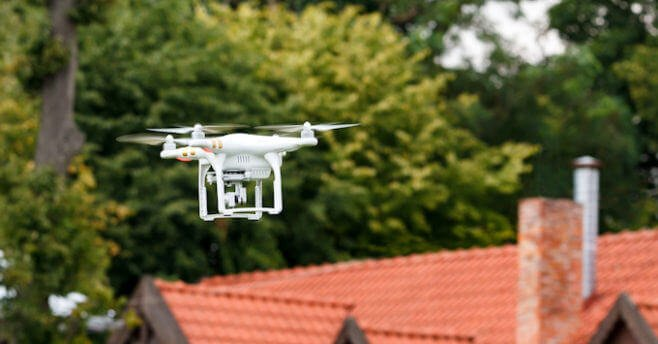 A drone flying in a yard
