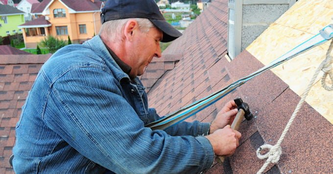 Roofing contractor working on a roof