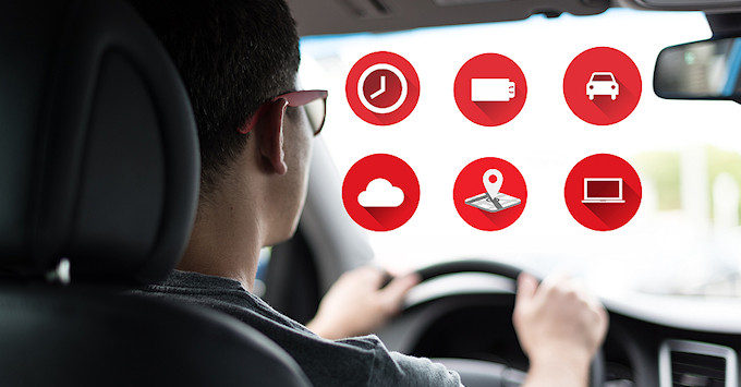 Man driving in a car with telematics installed
